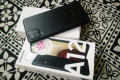 Samsung A12 128GB black in color brand new - Photos